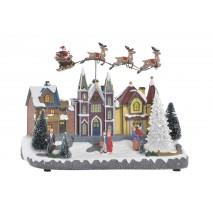 Maisons ou village illuminé de Noël avec mouvement.